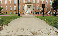 NWA Democrat-Gazette/ANDY SHUPE<br /> Damage is evident Friday, Aug. 21, 2015, on the 1906 section of the Senior Walk on the east side of Old Main on the University of Arkansas campus in Fayetteville. University officials are considering a course of action to repair or replace the damaged sections.