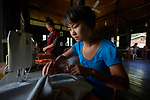 Women learn tailoring skills in a class sponsored by the Methodist Church in Kalay, a town in Myanmar.