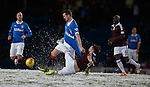 Rangers striker Jon Daly battling in the snow with Danny Wilson