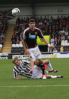 Callum Paterson beats Marc McAusland in the St Mirren v Heart of Midlothian Clydesdale Bank Scottish Premier League match played at St Mirren Park, Paisley on 15.9.12.