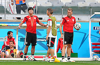 Germany coach Joachim Loew gestures as he talks with Bastian Schweinsteiger during training ahead of tomorrow's semi final vs Brazil