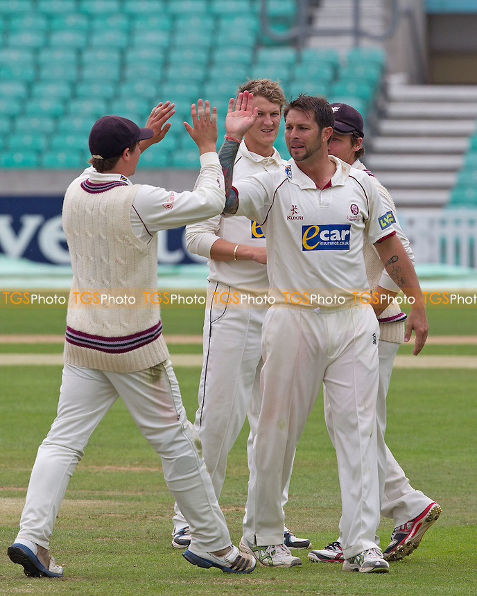 Peter Trego is congratulated by his Somerset team mates - Surrey CCC v Somerset CCC - LV County Championship, Division1 cricket at The Kia Oval - 19/05/12 - MANDATORY CREDIT: Ray Lawrence/TGSPHOTO - Self billing applies where appropriate - 0845 094 6026 - contact@tgsphoto.co.uk - NO UNPAID USE.