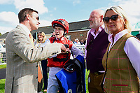 Trainer Richard Hughes and jockey Finley Marsh talk to connections of Beepeecee in the winners enclosure during Afternoon Racing at Salisbury Racecourse on 13th June 2017