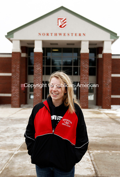 Winsted, CT- 26 January 2014-012614CM05-  Mady Malcynski, 16, of Torrington poses for a photo outside of Northwestern Regional School in Winsted on Sunday. Malcynski is one of the high number of students who have left her school district to attend another school. Christopher Massa Republican-American