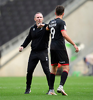 Lincoln City manager Michael Appleton, left,celebrates the victory with Tom Hopper<br /> <br /> Photographer Chris Vaughan/CameraSport<br /> <br /> The EFL Sky Bet League One - Milton Keynes Dons v Lincoln City - Saturday 19th September 2020 - Stadium MK - Milton Keynes<br /> <br /> World Copyright © 2020 CameraSport. All rights reserved. 43 Linden Ave. Countesthorpe. Leicester. England. LE8 5PG - Tel: +44 (0) 116 277 4147 - admin@camerasport.com - www.camerasport.com