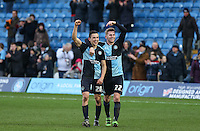 Jason McCarthy of Wycombe Wanderers points to winning goal scorer Luke O'Nien of Wycombe Wanderers at the final whistle during the Sky Bet League 2 match between Wycombe Wanderers and Bristol Rovers at Adams Park, High Wycombe, England on 27 February 2016. Photo by Andrew Rowland.