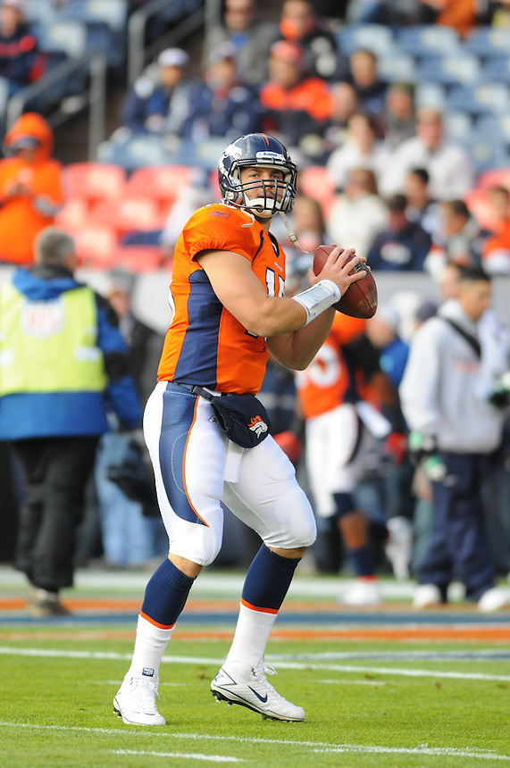 14 NOVEMBER 2010:  Tim Tebow warms up before a regular season National Football League game between the Kansas City Chiefs and the Denver Broncos at Invesco Field at Mile High in Denver, Colorado. The Broncos beat the Chiefs 49-29.