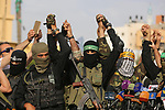 Representatives of various Palestinian armed factions take part in a news conference in support of Palestinian prisoners on hunger strike in Israeli jails, in Gaza City May 18, 2017. Photo by Ashraf Amra