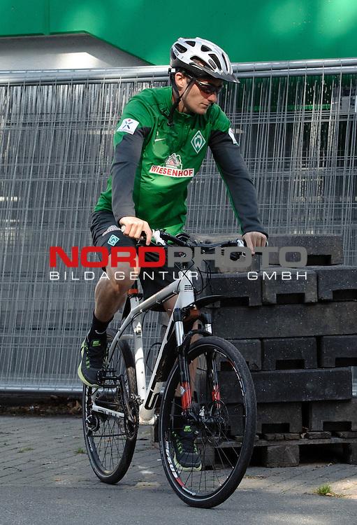 24.08.2013, Trainingsgelaende, Bremen, GER, 1.FBL, Training Werder Bremen, im Bild Luca Caldirola (Bremen #3) mit Fahrrad<br /> <br /> Foto &copy; nph / Frisch