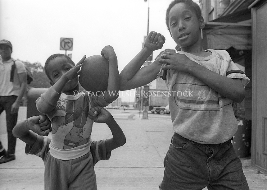 Children play basketball outside the Terminal Hotel on West 23rd Street near the West Side Highway.