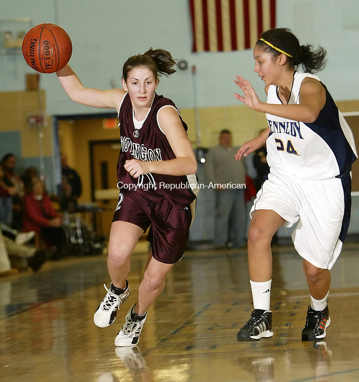 WATERBURY, CT, 01/09/08- 010909BZ10-  Torrington's Brooke Johnson (10) drives past Kennedy's Maisie Johnson (24) Friday night. <br />  Jamison C. Bazinet Republican-American
