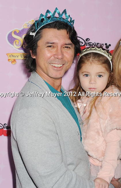 "BURBANK, CA - NOVEMBER 10: Lou Diamond Phillips and family arrive at the Disney Channel's Premiere Party For ""Sofia The First: Once Upon A Princess"" at the Walt Disney Studios on November 10, 2012 in Burbank, California."