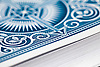 Stack of playing cards, blue and white patterned reverse on the top.