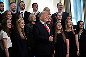 United States President Donald J. Trump poses with athletes from the Queens University Charlotte Swim Team as part of NCAA Collegiate National Champions Day at the White House in Washington on November 22, 2019. <br /> Credit: Yuri Gripas / Pool via CNP