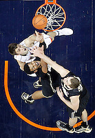 Virginia forward/center Mike Tobey (10) reaches for the rebound with Wake Forest center Andre Washington (31) and Wake Forest forward Tyler Cavanaugh (34) during the game Wednesday Jan. 08, 2014 in Charlottesville, Va. Virginia defeated Wake Forest 74-51.