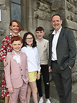 Ollie Carley from St. Mary's school who received First Holy Communion in St. Mary's churchpictured with his family .  Photo:Colin Bell/pressphotos.ie