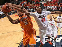 Tennessee forward Jarnell Stokes (5) grabs the rebound next to Virginia forward Darion Atkins (32) during the game Wednesday in Charlottesville, VA. Virginia defeated Tennessee 46-38.