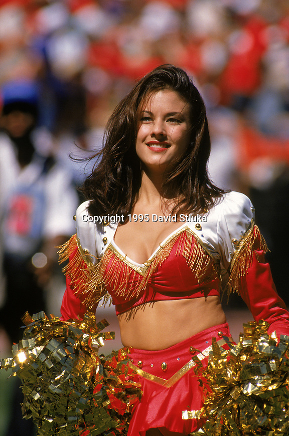 A San Francisco 49ers cheerleader cheers during an NFL football game against the New York Giants at 3Com Park on October 1,1995 in San Francisco, California. The 49ers won 20-6. (Photo by David Stluka)