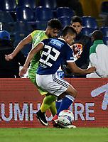 BOGOTA - COLOMBIA - 25 – 03 - 2018: Jhon Duque (Der.) jugador de Millonarios disputa el balón con Juan Villota (Izq.) jugador de Jaguares F. C., durante partido de la fecha 10 entre Millonarios y por la Liga Aguila I 2018, jugado en el estadio Nemesio Camacho El Campin de la ciudad de Bogota. / Jhon Duque (R) player of Millonarios vies for the ball with Juan Villota (L) player of Jaguares F. C., during a match of the 10th date between Millonarios and Jaguares F. C., for the Liga Aguila I 2018 played at the Nemesio Camacho El Campin Stadium in Bogota city, Photo: VizzorImage / Luis Ramirez / Staff.