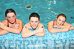 SWIMMERS: Georgia O'Brien, Jordan Whyte and Lauren Tanner pictured in Kenmare Bay Leisure Centre with the medals they won at their first competitive swimming gala in Cork last weekend.