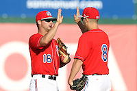 Andrew Heid #16 of the Inland Empire 66'ers greets teammate Taylor Lindsey #8 after win against the High Desert Mavericks at San Manuel Stadium on April 29, 2012 in San Bernardino,California. Inland Empire defeated High Desert 3-0.(Larry Goren/Four Seam Images)