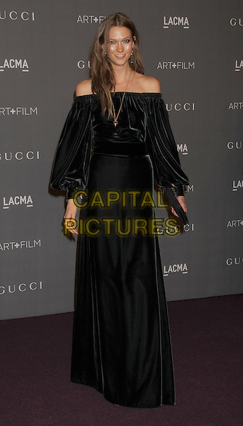 Karlie Kloss.at The LACMA 2012 Art and Film Gala held at LACMA in Los Angeles, California, USA, October 27th 2012..full length dress green black velvet clutch bag black off the shoulder gold necklace .CAP/ROT/TM.© TM/Roth/Capital Pictures