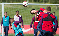Harry Maguire and Raheem Sterling during the part open training session of the  England national football squad at St George's Park, Burton-Upon-Trent, England on 31 August 2017. Photo by James Williamson.