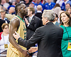 Mar. 28, 2015; Notre Dame president Rev. John Jenkins, C.S.C. greets Jerian Grant (22) after the 2015 NCAA Tournament regional final against Kentucky. (Photo by Matt Cashore/University of Notre Dame)