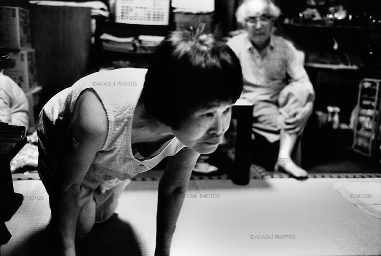 Yuriko, 58, cannot walk alone...August 2002.