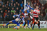 Doncaster Rovers v Sheffield Wednesday<br /> 22.3.2014<br /> Sky Bet League Championship<br /> Picture Shaun Flannery/Trevor Smith Photography<br /> Rovers Abdoulaye Meite clears the ball from Wednesday's Atdhe Nuhiu and Leon Best.