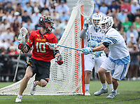 Baltimore, MD - April 28, 2018: Maryland Terrapins Jared Bernhardt (10) holds off a Johns Hopkins Blue Jays defender during game between John Hopkins and Maryland at  Homewood Field in Baltimore, MD.  (Photo by Elliott Brown/Media Images International)