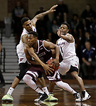 SIOUX FALLS, SD: MARCH 23: Thomas Wimbush #20 from Fairmont State reaches over to knock the ball from Al Davis #3 from Bellarmine during the Men's Division II Basketball Championship Tournament on March 23, 2017 at the Sanford Pentagon in Sioux Falls, SD. (Photo by Dick Carlson/Inertia)