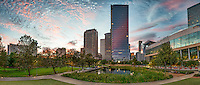 Sunset at Discovery Green Pano -  This is a pano of the Discovery Green Park in downtown Houston just as the sun is being to set.  The reflective high rise has picked up the pink colors in the sky as the sun sets over the cityscape of this modern urban environment. Watermark will not appear on image