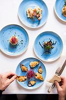 A plentiful seafood antipasto serving at Trattoria Il Brigante, Monopoli, Puglia, Italy