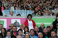 Barclay Premier League, Swansea City (white) V Liverpool (red) Liberty Stadium, 13/05/12<br /> Pictured: The Liberty Stadium looked more like Graceland this afternoon with fans dressed as Elvis Presley.<br /> Picture by: Ben Wyeth / Athena <br /> info@athena-pictures.com