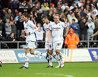 Pictured: (L-R) Angel Rangel, Ferrie Bodde and Thomas Butler of Swansea City in action <br />