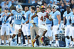 24 November 2012: Maryland's Brandon Ross (45) is chased down the sideline by UNC's Tre Boston (10). The University of North Carolina Tar Heels played the University of Maryland Terrapins at Kenan Memorial Stadium in Chapel Hill, North Carolina in a 2012 NCAA Division I Football game. UNC won 45-38.