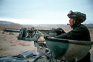 Fort Irwin, California - September 17, 1985. A tank and U.S. military personal training at the National Training Center located in the Mojave Desert. Opened on October 16, 1980, this facility is the primary training area for the United States Military.
