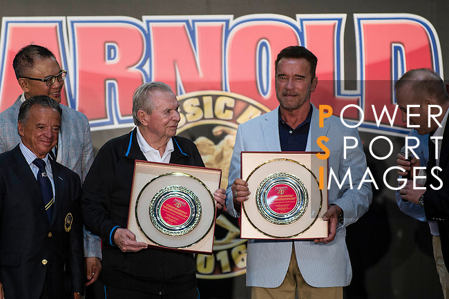 Jim Lorimer (l) Arnold Schwarzenegger's partnership and Arnold on stage pose for photos after being honoured during the Arnold Classic Asia 2016 Multi-Sport Festival on 20 August 2016 at the AsiaWorld-Expo, Hong Kong. Poto by Marcio Machado / Power Sport Images