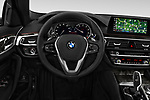 Car pictures of steering wheel view of a 2018 BMW 5 Series 540i Sport Line 4 Door Sedan
