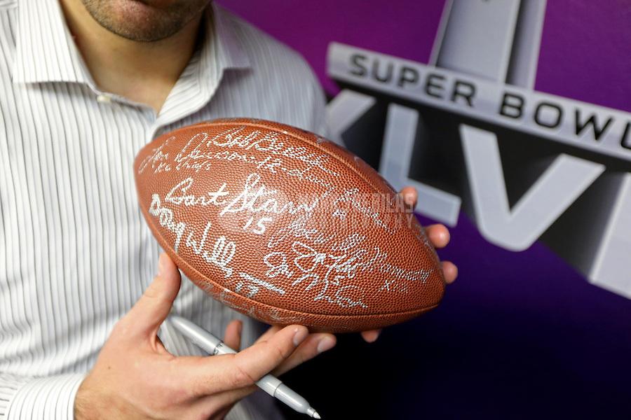Feb 3, 2013; New Orleans, LA, USA; Baltimore Ravens quarterback Joe Flacco points towards a football signed by past Super Bowl quarterbacks following Super Bowl XLVII against the San Francisco 49ers at the Mercedes-Benz Superdome. Mandatory Credit: Mark J. Rebilas-