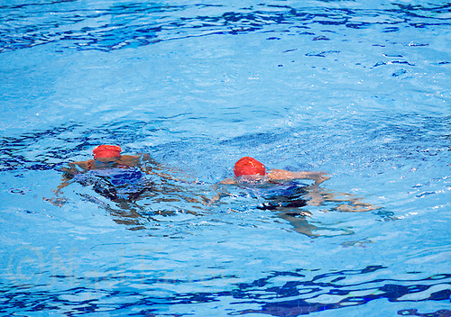 26 JUL 2012 - LONDON, GBR - Great Britain synchronised swimmers Jenna Randall (GBR) (left) and Olivia Federici (GBR) (right) practice a section of their duet routine in the pool at the Aquatics Centre in the Olympic Park, Stratford, London, Great Britain ahead of the start of the London 2012 Olympic Games (PHOTO (C) 2012 NIGEL FARROW)