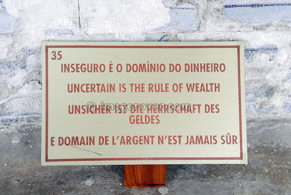 "Brazil, Bahia, Salvador: Shield belonging to an Azulejo, a portuguese ceramic tilework, in the church Igreja e Convento de São Francisco illustrating the saying ""insecure e o domino do dinheiro"" (uncertain is the rule of wealth, unsicher ist die herrschaft des geldes, edomain de l'argent n'est jamais sur). --- No signed releases available."