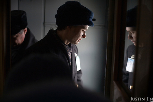 A train conductor prepares for stopping in Yekaterinburg in central Russia. The train, beginning in Berlin, Germany, goes through Poland and Belarus, and ends in Irkutsk, Russia. The entire journey takes six days.