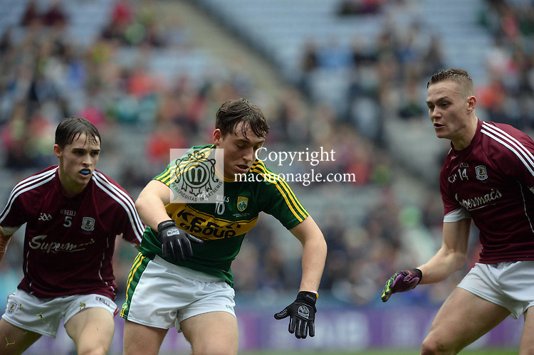 Kerry's Dara Moynbihan under pressure from Galways's Sean Raferty in the All-Ireland Minor final at Croke on Sunday.<br /> Photo: Don MacMonagle