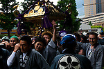 Parade with shrine during 2008 Kanda Matsuri celebrations, Tokyo carrying  a golden mikoshi or shrine. While the parades during even numbered years are nowhere near the magnitude of the odd numbered years, these partipants - born in bred in Kanda (or central Edo, as Tokyo was once known), are known as Edokkos, and they are proud to be known as an energetic, high-spirited community.....The festival is also known as Tenka Matsuri - the Shogun Festival. It is one of the three biggest festival in Japan.This festival was permitted to enter the Edo Castle (the Imperal Palace)in Edo period.....During the festival lots of Mikoshi or portable shrines, are carried by crowds of local people and paraded throughout Kanda and Nihonbasi towns.....Mikoshis are beautiful gold and black lacquer portable versions of the shrine's kamis or deities, taken out on a march through the streets of the town, so that blessings - in the shape of luck and prosperity are given to the area and the people who liver the. The more the mikoshi is shaken, the more blessings the god will give!