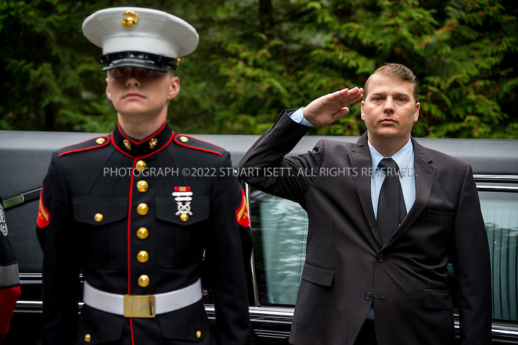 9/30/2016-- Tahoma National Cemetery, Kent, WA, USA<br /> <br /> James Lindley, 34 (right), an undertaker and US Marine Corp Veteran, salutes while the remains of 4 veterans are placed in a commitment shelter at Tahoma National Cemetery.<br /> <br /> On this day, with the help of Mr. Lindley, the remains of 4 veterans were interred at the Tahoma National Cemetery: <br /> <br /> Richard Fesler, born 1951, died 2014. US Army Veteran<br /> Rocky Stallone, born 1951, died 2014. Marine Corps veteran<br /> Russell Ristow, born 1944, died 2014. US Army veteran.<br /> Wayne Roberts, Born 1937, died 2014. US Navy veteran.<br /> <br /> <br /> Credit: Stuart Isett for The Wall Street Journal. <br /> VETBODIES<br /> <br /> &copy;2016 Stuart Isett. All rights reserved.
