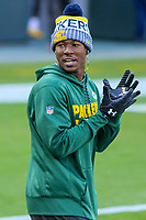 Green Bay Packers running back Jamaal Williams (30) plays catch with fans in the stands prior to a National Football League game against the Tampa Bay Buccaneers on December 2nd, 2017 at Lambeau Field in Green Bay, Wisconsin. Green Bay defeated Tampa Bay 26-20. (Brad Krause/Krause Sports Photography)