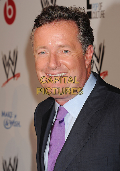 Piers Morgan<br /> WWE &amp; E! Entertainment's &quot;SuperStars For Hope&quot; supporting Make-A-Wish at The Beverly Hills Hotel in Beverly Hills, CA., USA.<br /> August 15th, 2013<br /> headshot portrait black suit purple tie blue shirt grey gray<br /> CAP/ROT/TM<br /> &copy;Tony Michaels/Roth Stock/Capital Pictures