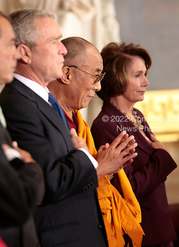 The Dalai Lama stands between U.S. President George W. Bush and Speaker of the House Nancy Pelosi during a Congressional Gold Medal ceremony in the US Capitol in Washington DC USA on 17 October 2007.